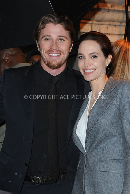 WWW.ACEPIXS.COM<br /> December 2, 2014 New York City<br /> <br /> Garrett Hedlund and Angelina Jolie leaving the New York luncheon honoring Universal's &quot;Unbroken&quot;<br /> on December 02, 2014 at Metropolitan Club in New York City.<br /> <br /> Please byline: Kristin Callahan/AcePictures<br /> <br /> ACEPIXS.COM<br /> <br /> Tel: (212) 243 8787 or (646) 769 0430<br /> e-mail: info@acepixs.com<br /> web: http://www.acepixs.com