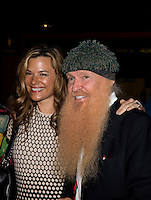 Aug. 29, 2013; Avon, IN, USA: ZZ Top guitarist/vocalist Billy Gibbons (right) on the red carpet with wife Gilligan Gibbons prior to the premiere of Snake & Mongoo$e at the Regal Shiloh Crossing Stadium 18. Mandatory Credit: Mark J. Rebilas-