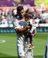 Pictured: Jordi Amat with his baby son. Saturday 23 August 2014<br />