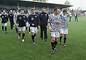 Dejected Queens Park players leave the park at the end of the game.