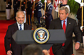 Washington, D.C. - June 24, 2005 -- United States President George W. Bush and Prime Minister Ibrahim al-Jaafari of Iraq step to the podium prior to a joint press conference in the East Room at the White House in Washington, D.C. on June 24, 2005.  They discussed the re-building of Iraq and refused to give a time-table for the withdrawal of United States forces.<br /> Credit: Ron Sachs / CNP