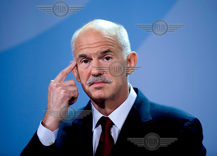 Greek prime minister Georgios Papandreou at a press conference in Berlin. ..