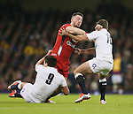 Alex Cuthbert of Wales tackled by Ben Youngs and George Ford of England - RBS 6Nations 2015 - Wales  vs England - Millennium Stadium - Cardiff - Wales - 6th February 2015 - Picture Simon Bellis/Sportimage