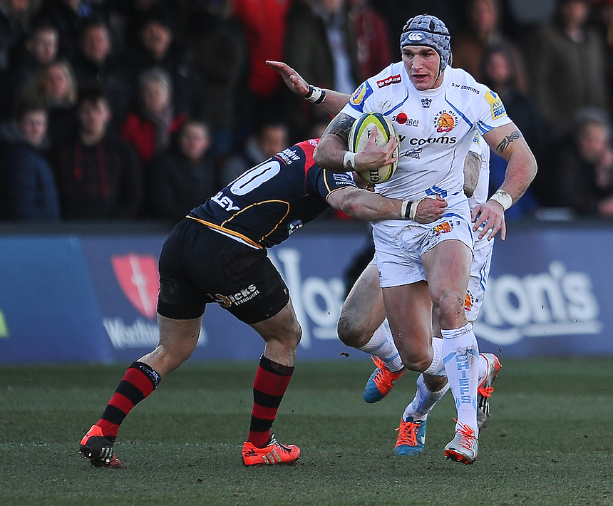 Exeter Chiefs' Tom James is tackled by Newport Gwent Dragons' Dorian Jones<br /> <br /> Photographer Craig Thomas/CameraSport<br /> <br /> Rugby Union - European Rugby Challenge Cup Pool 3 - Newport Gwent Dragons v Exeter Chiefs - Sunday 1st February  2015 - Rodney Parade - Newport <br /> <br /> &copy; CameraSport - 43 Linden Ave. Countesthorpe. Leicester. England. LE8 5PG - Tel: +44 (0) 116 277 4147 - admin@camerasport.com - www.camerasport.com