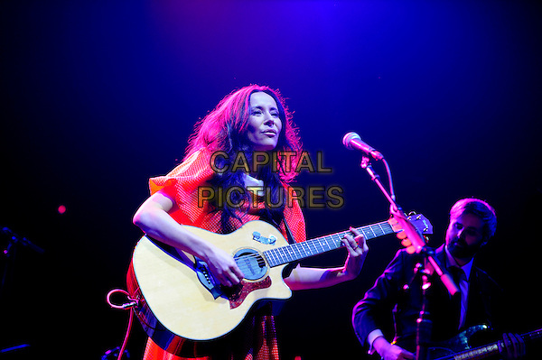 Nerina Pallot <br /> performing in concert, LG Arena, Birmingham, England, UK, <br /> 21st September 2013.<br /> music live on stage gig half length singing microphone playing guitar red dress  <br /> CAP/MAR<br /> &copy; Martin Harris/Capital Pictures