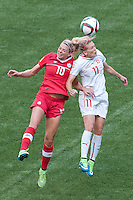 June 21, 2015: Lauren SESSELMANN of Canada and Lara DICKENMANN of Switzerland jump for the ball during a round of 16 match between Canada and Switzerland at the FIFA Women's World Cup Canada 2015 at BC Place Stadium on 21 June 2015 in Vancouver, Canada. Canada won 1-0. Sydney Low/Asteriskimages.com