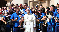 Papa Francesco posa per una foto con alcuni membri della Federazione Italiana Sport Cinofili (FISC) al termine dell'udienza generale del mercoledi' in Piazza San Pietro, Citta' del Vaticano, 12 settembre 2018.<br /> Pope Francis poses for a photo with members of the Italian Dog Sports Federation (Federazione Italiana Sport Cinofili FISC) at the end of his weekly general audience in St. Peter's Square at the Vatican, on September 12, 2018.<br /> UPDATE IMAGES PRESS/Isabella Bonotto<br /> <br /> STRICTLY ONLY FOR EDITORIAL USE