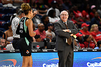 Washington, DC - August 25, 2019: Washington Mystics head coach Mike Thibault shares a moment with former Washington Mystics player Bria Hartley (14) during first half action of game between the New York Liberty and the Washington Mystics at the Entertainment and Sports Arena in Washington, DC. The Mystics defeated New York 101-72. (Photo by Phil Peters/Media Images International)