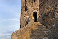 "Stairs leading to the main entrance, Queribus Castle or Chateau de Queribus, Cathar Castle, Cucugnan, Corbieres, Aude, France. This castle, built from 13th to 16th centuries, is considered the last Cathar stronghold. It sits on a high peak at 728m. It is one of the ""Five Sons of Carcassonne"" or ""Cinq Fils de Carcassonne"". It is a listed monument historique and has been fully restored, restoration work being completed in 2002. Picture by Manuel Cohen"