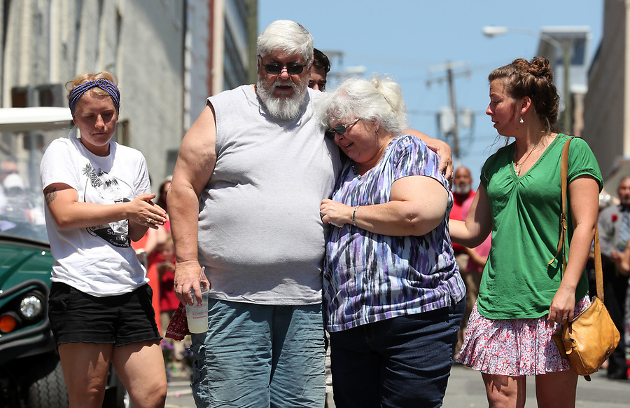 Surrounded by supporters, Kim and Susan Bro, middle, became emotional on Saturday as the visited the site where Heather Heyer died exactly one week ago after a car plowed through a group of people on 4th Street SE. This was the couple&rsquo;s first visit to the site. Photo/Andrew Shurtleff<br /> t