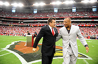 Sept. 13, 2009; Glendale, AZ, USA; Arizona Cardinals team president Michael Bidwill (left) congratulates former player Aeneas WIlliams after he was inducted into the Cardinals Ring of Honor before the game against the San Francisco 49ers at University of Phoenix Stadium. San Francisco defeated Arizona 20-16. Mandatory Credit: Mark J. Rebilas-