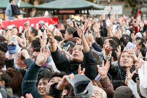 People try to catch soybeans bags during the Setsubun festival at Naritasan Shinshoji Temple on February 3, 2017, in Chiba, Japan. Setsubun is an annual festival celebrated on February 3rd marking the day before the beginning of Spring. Japanese families throw soybeans out of the house to ward off evil spirits and into the house to invite good fortune. Japanese actors and sumo wrestlers are invited to participate in the ceremony at Naritasan Shinshoji Temple which holds one of the biggest events in Japan. (Photo by Rodrigo Reyes Marin/AFLO)