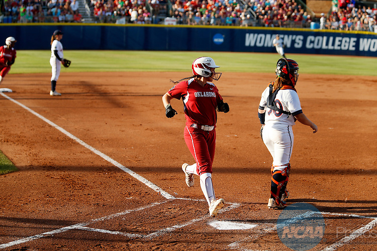 07 JUNE 2016:  Oklahoma outfielder Erin Miller (48) crosses home plate to score during the Division I Women's Softball Championship is held at ASA Hall of Fame Stadium in Oklahoma City, OK.  Shane Bevel/NCAA Photos