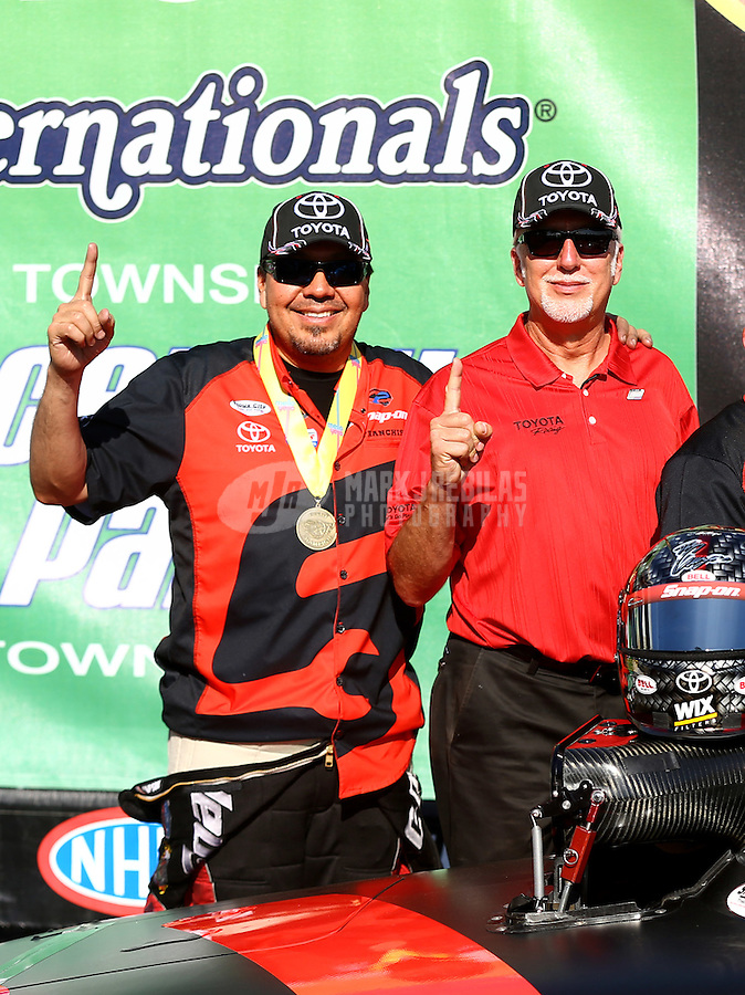 Jun. 1, 2014; Englishtown, NJ, USA; NHRA funny car driver Cruz Pedregon celebrates with Toyota staff after winning the Summernationals at Raceway Park. Mandatory Credit: Mark J. Rebilas-