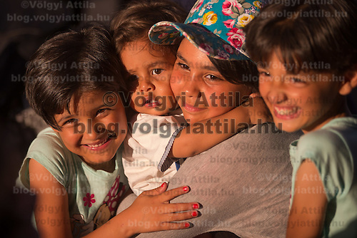 Illegal migrant children pose for a photo before they get on their train to travel to Germany at the main railway station Keleti in Budapest, Hungary on August 31, 2015. ATTILA VOLGYI
