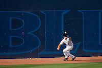 """Left fielder Chris Herrmann #4 of the Miami Hurricanes makes a catch in front of the """"Blue Monster"""" at Durham Bulls Athletic Park May 21, 2009 in Durham, North Carolina.  (Photo by Brian Westerholt / Four Seam Images)"""