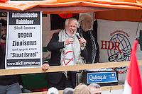 Ca. 1000 Menschen protestierten am Samstag den 11. Juli 2015 in Berlin mit einer Demonstration anlaesslich des anti-israelischen Al Quds-Tag. Sie riefen Parolen wie &quot;Kindermoerder Israel&quot; und &quot;Israel raus aus Palaestina&quot;.<br /> Am sogenannten Al Quds-Tag protestieren weltweit Muslime gegen die Besetzung der palaestinensischen Gebiete durch Israel.<br /> Etwa 2050 bis 300 Menschen protestierten gegen die Demonstration.<br /> Im Bild: Juergen Grassmann, Veranstalter der Al Quds- Demonstration von der Quds AG.<br /> 11.7.2015, Berlin<br /> Copyright: Christian-Ditsch.de<br /> [Inhaltsveraendernde Manipulation des Fotos nur nach ausdruecklicher Genehmigung des Fotografen. Vereinbarungen ueber Abtretung von Persoenlichkeitsrechten/Model Release der abgebildeten Person/Personen liegen nicht vor. NO MODEL RELEASE! Nur fuer Redaktionelle Zwecke. Don't publish without copyright Christian-Ditsch.de, Veroeffentlichung nur mit Fotografennennung, sowie gegen Honorar, MwSt. und Beleg. Konto: I N G - D i B a, IBAN DE58500105175400192269, BIC INGDDEFFXXX, Kontakt: post@christian-ditsch.de<br /> Bei der Bearbeitung der Dateiinformationen darf die Urheberkennzeichnung in den EXIF- und  IPTC-Daten nicht entfernt werden, diese sind in digitalen Medien nach &sect;95c UrhG rechtlich geschuetzt. Der Urhebervermerk wird gemaess &sect;13 UrhG verlangt.]
