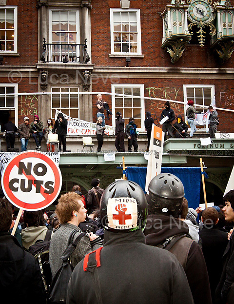 "London, 26/03/2011. ""The 2011 anti-cuts protest in London"" organised by the TUC (Trade Union Congress) saw around 500,000 people gather and march in central London. The march was called against the spending cuts being made by the Coalition Government (Conservative party and Liberal Democrats party). The main rally started from Victoria Embankment, and marched through Parliament Square and Whitehall, before terminating in Hyde Park. However, during the day 'splinter' groups of protesters staged direct actions at shops such as Fortum & Mason, and several banks. Police forces heavily armed with riot control equipment tried to contain the crowds and several times used the 'kettling' tactic. The West End first (Soho, Oxford Circus, Piccadilly Road, Piccadilly Circus, and nearby locations), then Trafalgar Square later in the evening, were the main locations of clashes between police officers and protesters.  The day of protests ended with 201 people arrested and more than 60 injured."