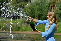 January 28, 2018: The 2018 Australian Open Women's Champion Caroline Wozniacki of Denmark sprays champagne for the media at the Botanical Gardens in Melbourne, Australia. Photo Sydney Low