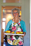 "Haiku Cannery Inn, Haiku, Maui, Hawaii. Madelyn ""Benni"" D'Enbeau, owner, serves up fresh, local papaya and strawberries to guests at the Bed and Breakfast located in Upcountry Maui."