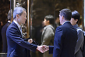 Ahn Ho-young (l), Ambassador of South Korea to the United States, shakes hands with retired Lt. Gen. Michael Flynn, President-elect Donald Trump's pick for National Security Adviser,  in lobby of the Trump Tower in New York, NY, on January 4, 2017.<br /> Credit: Anthony Behar / Pool via CNP