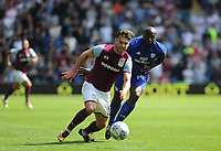 Aston Villa's Scott Hogan vies for possession with Cardiff City's Souleymane Bamba<br /> <br /> Photographer Ashley Crowden/CameraSport<br /> <br /> The EFL Sky Bet Championship - Cardiff City v Aston Villa - Saturday August 12th 2017 - Cardiff City Stadium - Cardiff<br /> <br /> World Copyright &copy; 2017 CameraSport. All rights reserved. 43 Linden Ave. Countesthorpe. Leicester. England. LE8 5PG - Tel: +44 (0) 116 277 4147 - admin@camerasport.com - www.camerasport.com
