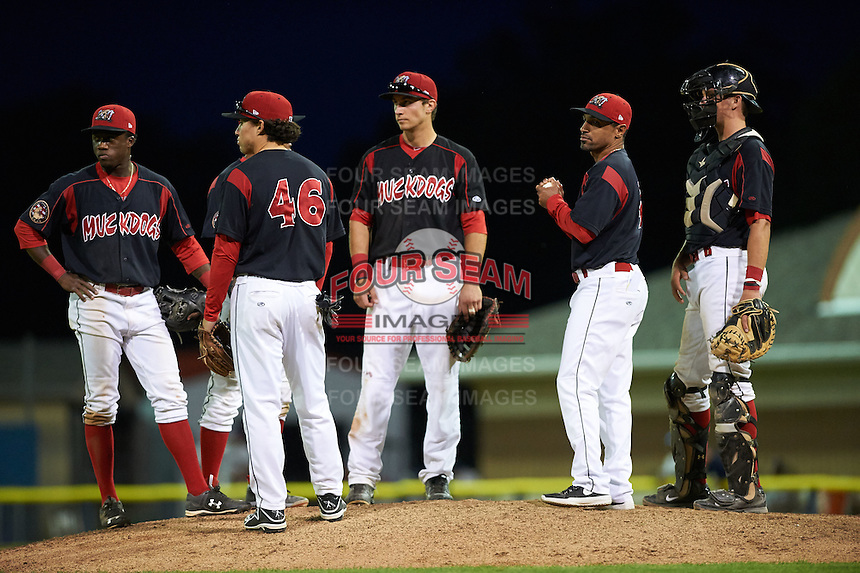 Batavia Muckdogs manager Angel Espada (4) makes a pitching change as (L-R) Anfernee Seymour, Giovanny Alfonzo (hidden), Joseph Chavez (46), Eric Fisher and Blake Anderson look on during a game against the Mahoning Valley Scrappers on July 3, 2015 at Dwyer Stadium in Batavia, New York.  Batavia defeated Mahoning Valley 7-4.  (Mike Janes/Four Seam Images)