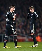 FUSSBALL  CHAMPIONS LEAGUE  ACHTELFINALE  HINSPIEL  2012/2013      FC Arsenal London - FC Bayern Muenchen       19.02.2013 Bastian Schweinsteiger (li) und Toni Kroos (re, beide FC Bayern Muenchen)
