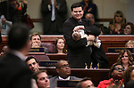 Assemblyman David Gardner, R-Las Vegas, holds his 3-month-old son Callum as Gov. Brian Sandoval asks freshmen lawmakers stand to be recognized during his State of the State address at the Legislative Building in Carson City, Nev., on Thursday night, Jan. 15, 2015. (Las Vegas Review-Journal/Cathleen Allison)