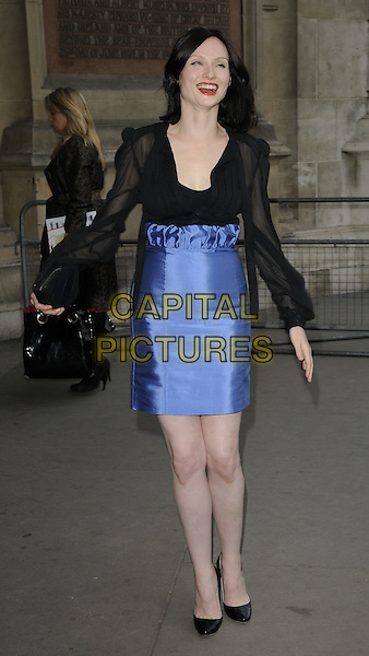 SOPHIE ELLIS BEXTOR.Lulu Guinness' 20th Anniversary Party at the Victoria and Albert Museum, London, England..June 8th, 2009.V&A V & A full length black sheer blouse top silk satin blue high waist skirt clutch bag shoes.CAP/CAN.©Can Nguyen/Capital Pictures.