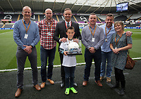Lee Trundle with match ball sponsors during the Premier League match between Swansea City and Everton at The Liberty Stadium, Swansea, Wales, UK. Saturday 06 May 2017