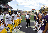California captains' Trevor Guyton, D.J. Holt, Marvin Jones, and Mitchell Schwartz and Washington captains watch referee Michael Batlan tosses a coin before the game at Seattle, Washington on September 24th, 2011.  Washington defeated California 31-23.