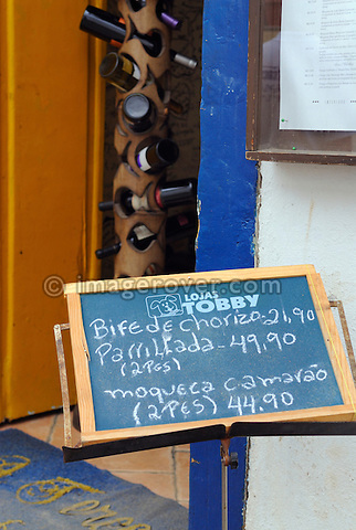 Paraty, Espirito Santo, Brazil: Inviting sign to a restaurant in Paraty's historic centre. --- Info: The beautiful colonial town of Paraty has been a UNESCO World Heritage Site since 1958. --- No signed releases available.