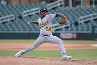 Mesa Solar Sox relief pitcher Miguel Romero (54) of the Oakland Athletics organization, delivers a pitch to the plate during an Arizona Fall League game against the Salt River Rafters on October 30, 2017 at Salt River Fields at Talking Stick in Scottsdale, Arizona. The Solar Sox defeated the Rafters 8-4. (Zachary Lucy/Four Seam Images)