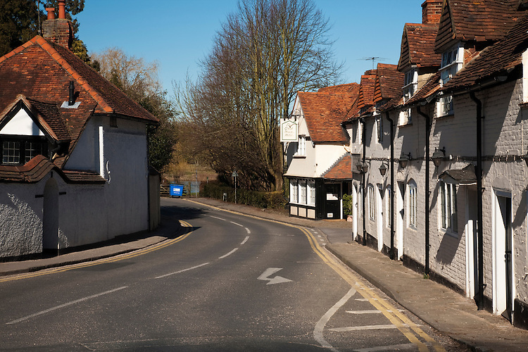 View along Thames Street in Sonning on Thames looking towards The Great House and Sonning Bridge, Berkshire, Uk