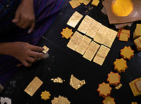The Jade Market in Mandalay, Myanmar, Burma Traditional gold leaf production in Mandalay, Myanmar