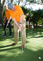 """Occidental College officially opened its new 2,500 square-foot golf practice facility and putting green with a ribbon cutting ceremony on Saturday, April 18, 2015.<br /> The Andrew E. Rubin Practice Facility includes the Pongracz and Wright Families Putting Green and The Tiger Hitting Bays. It is thanks to the generosity of alumni Andrew Rubin, Andrew and Stephanie Pongracz, Peter and Shira Wright, and Ben and Ashley Phelps.<br /> Oxy athletic director Jaime Hoffman spoke about the Athletic Department's vision to """"bring its student-athletes back to campus,"""" head golf coach Andrew Larkin gave an update on both the men's and women's programs and there were three separate ribbon-cutting photo opportunities for the alumni donors.<br /> (Photo by Kirby Lee, Freelance)"""