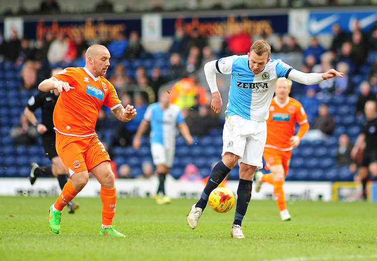 Blackburn Rovers' Jordan Rhodes gets a shot away as he is closed down by Blackpool's Jamie O'Hara<br /> <br /> Photographer Andrew Vaughan/CameraSport<br /> <br /> Football - The Football League Sky Bet Championship - Blackburn Rovers v Blackpool - Saturday 21st February 2015 - Ewood Park - Blackburn<br /> <br /> &copy; CameraSport - 43 Linden Ave. Countesthorpe. Leicester. England. LE8 5PG - Tel: +44 (0) 116 277 4147 - admin@camerasport.com - www.camerasport.com