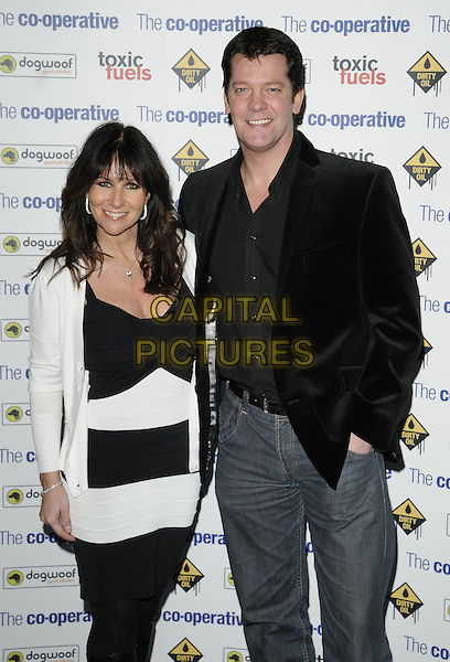 "LINDA LUSARDI & SAM KANE.The film premiere of ""Dirty Oil"", Barbican Centre, London, England.March 15th 2010.half length black white striped stripes  dress tights jacket blazer jeans coat married husband wife jeans denim cardigan.CAP/CAN.©Can Nguyen/Capital Pictures."