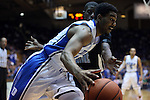 04 November 2014: Duke's Matt Jones (in white) drives past Livingstone's Eric Dubose (behind). The Duke University Blue Devils hosted the Livingstone College Blue Bears at Cameron Indoor Stadium in Durham, North Carolina in an NCAA Men's Basketball exhibition game.