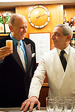 ITALY, Venice. Actor Peter Weller toasting with a Bellini at Harry's Bar for a New Year's Eve celebration.