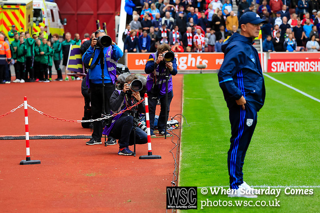 Stoke City 1 West Bromwich Albion 1, 24/09/2016. Bet365 Stadium, Premier League. Photographers shooting Tony Pulis Head Coach of West Bromwich Albion before his 1,000th match as a manager. Photo by Paul Thompson.