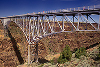 Rio Grande, steel bridge, NM, New Mexico, Rio Grande River, The three-span continuous-truss bridge crosses the Rio Grande Gorge near Taos. One of the highest bridges in the United States.