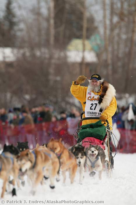 Dog Musher Charley Boulding leaves the shoot for the 1000 mile 2003 Iditarod sled dog race from Fairbanks to Nome, Alaska . Lack of snow along the normal trail route further south forced the relocation of the restart on the Chena River in Fairbanks.