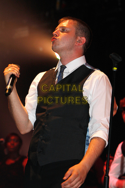 PLAN B - BEN DREW .Performing live at Wireless Festival 2010, Hyde Park, London, England, UK, July 2nd 2010..concert gig music on stage half length microphone  grey gray waistcoat white shirt tie blue .CAP/MAR.© Martin Harris/Capital Pictures.