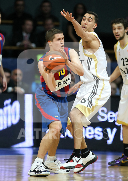 FC Barcelona's Jaka Lakovic (l) and Real Madrid's Pablo Prigioni during Euroleague Basketball match. March 30, 2010. (ALTERPHOTOS/Acero)