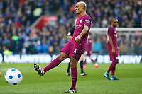 Vincent Kompany of Manchester City kicks a blow up beach ball off the beach as it brings a halt to play during the Fly Emirates FA Cup Fourth Round match between Cardiff City and Manchester City at the Cardiff City Stadium, Wales, UK. Sunday 28 January 2018