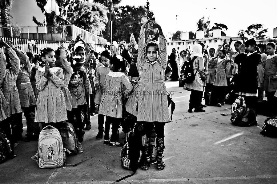 Gaza, Beit Hanoun: Shorouk, fille de Shady est &agrave; l'&eacute;cole de l'UNRWA a Beit Hanoun et fait sa gymnastique matinale dans la cours de recr&eacute;ation avant de commencer les cours. 27/10/2014<br /> <br /> Gaza, Beit Hanoun: Shorouk, Shady's  daughter is at a UNRWA school in Beit Hanoun and do her morning exercises in the court of recreation before starting classes. 27/10/2014