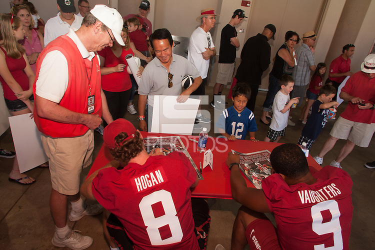STANFORD,CA-- August 24, 2013:Kevn Hogan_James Vaughters sign autographs Saturday afternoon.<br /> <br /> It was part the Stanford Football 2013 Open House.