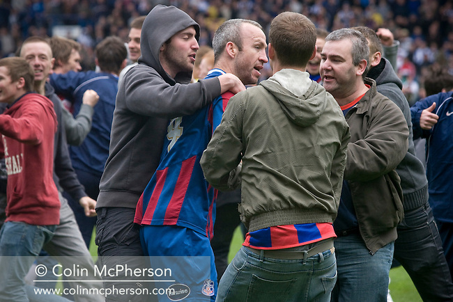 Crystal Palace captain Shaun Derry is engulfed by supporters celebrating on the pitch at Hillsborough after the final whistle of the crucial last-day relegation match against Sheffield Wednesday. The match ended in a 2-2 draw which meant Wednesday were relegated to League 1. Crystal Palace remained in the Championship despite having been deducted 10 points for entering administration during the season.